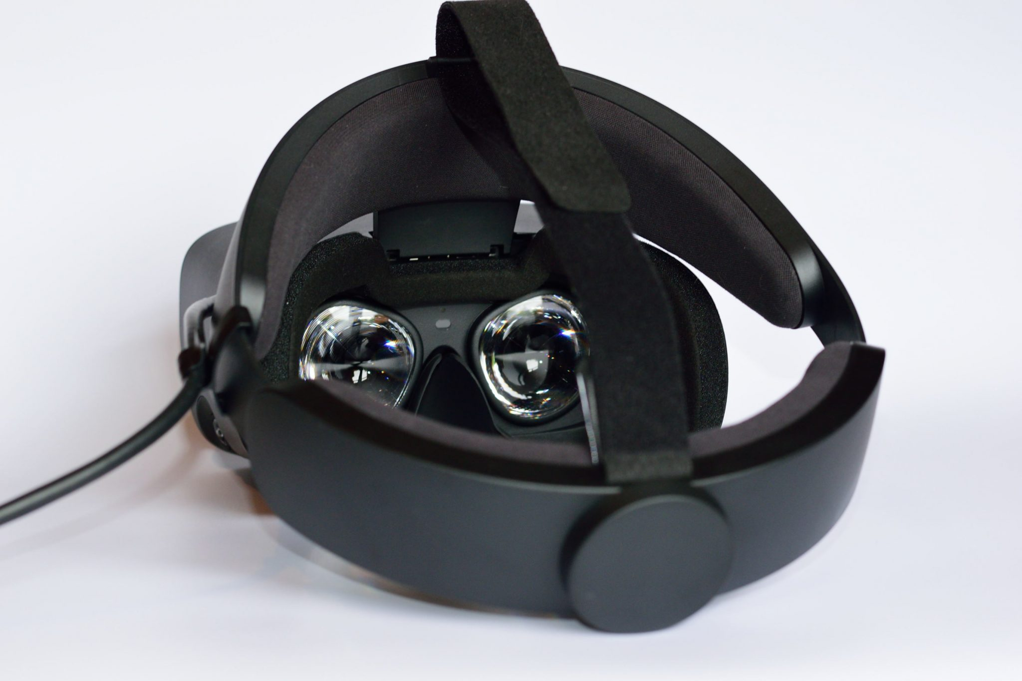 A rear view of the Oculus Rift S headset showing the strap, padding and lenses.